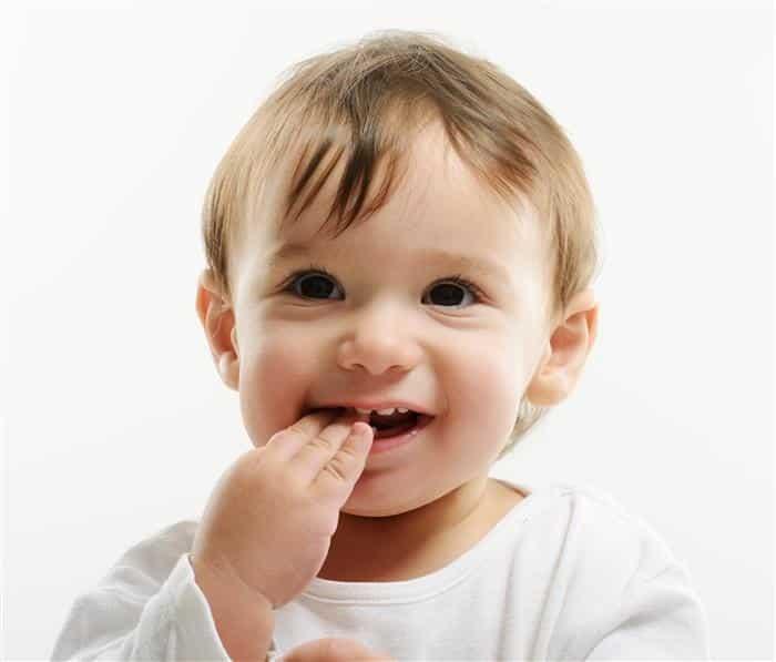 como arrancar dente de leite